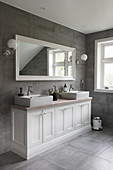 Classic bathroom in grey and white with twin sinks on washstand