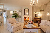 Lamps, lights and Christmas tree in shabby-chic living room