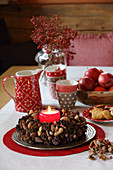 Handmade Advent wreath decorated with nuts, spices and pine cones