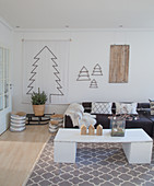 Stylised Christmas tree and DIY coffee table in bright living room