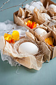 White eggs and yellow paper rosettes