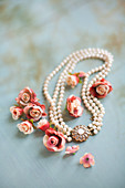 Roses and elegant pearl necklace