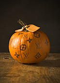 Pumpkin decorated with handbag brand logos