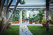 Conservatory with arched windows in Mediterranean garden