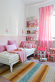 Pink girl's bedroom with two-tone wall
