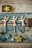 Festive reindeer decorations for cake or cookies with chocolates and fondant stars