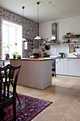 Open-plan kitchen-dining room in country-house style