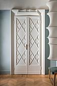 Restored, white double doors