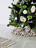Wreath of beach ware under a decorated Christmas tree