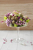Flower arrangement with artichokes and quail eggs