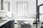 Free-standing bathtub in classic, black-and-white bathroom