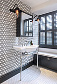 Patterned wall in classic black-and-white bathroom