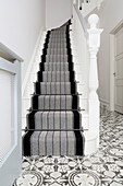 Striped stair runner on classic staircase