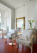 Two armchairs made from reclaimed wood in Mediterranean period apartment