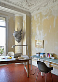 Desk in Mediterranean interior with distressed walls