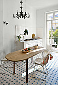 Classic tiled floor in Mediterranean kitchen-dining room
