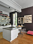 Eclectic mixture of modern styles in kitchen of French period apartment