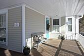 Bench on sunny, American-style veranda