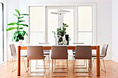 Dining table with designer chairs in a bright dining room