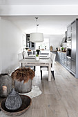 Dining table and upholstered chairs in open-plan kitchen