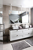 Washstand with square countertop sinks in grey bathroom