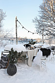 Set table with Christmas decorations in snow