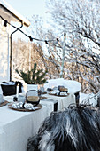 Set table with Christmas decorations in garden