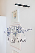 Wire-mesh decorative elephant with lettering reading 'Fat free'