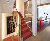 Elegant, open-plan stairwell and study with fitted cupboards