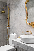 Marble, gilt and brass details in bathroom