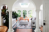Elegant lounge area with arched passage