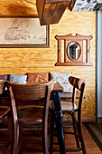 Rustic dining room with wood paneling