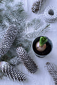 Christmas arrangement of fir branches and cones sprayed with artificial snow