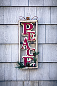 Christmas wall decoration with lettering spelling 'Peace'
