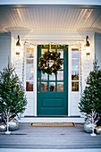 Festively decorated entrance area and front door