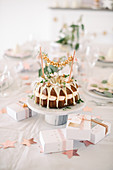 Bundt cake with garland on modern table set for Christmas