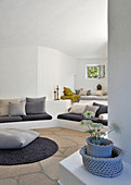 Cushions on masonry bench in white lounge