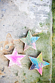 Wooden stars coloured in by children