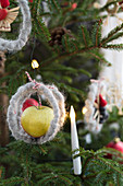 Christmas tree decorated with apples and candles