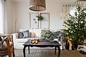 Christmas tree in cosy living room in natural shades
