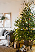 Simply decorated Christmas tree in basket in living room