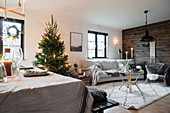 Christmas tree and board wall in cosy interior