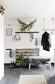 Christmas decorations in rustic foyer in grey and white