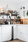 Festive vintage-style decorations in wood-clad kitchen