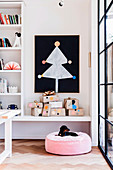 Stylized paper Christmas tree on black chalkboard, including gift on shelf and pillow with dog