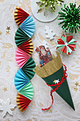 Christmas decorations hand-made from colourful paper