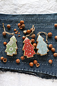 Colourful Christmas tree pendants on embroidered denim