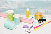 Materials for making Easter baskets from paper cups and craft paper