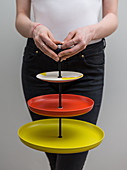 A homemade cakestand made from colourful plates