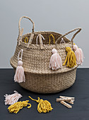 A basket decorated with homemade tassels
